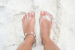 Feet on the white sand. Royalty Free Stock Images