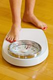 Feet of a woman on bathroom scales Royalty Free Stock Photos
