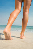 Feet of woman at the beach Stock Photos