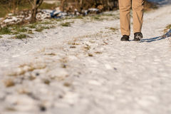 Feet of a woman with black shoes in the snow. Of a path Stock Image
