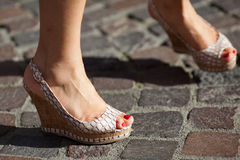 Feet of a woman on cobblestones Stock Images