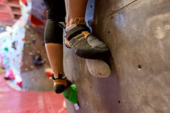 Feet of woman exercising at indoor climbing gym Royalty Free Stock Photo