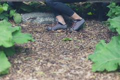 Feet of woman in forest Royalty Free Stock Image