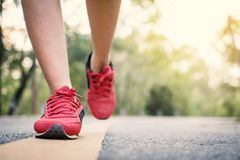 Feet woman running on the road for health. Color of vintage tone selective and soft focus Royalty Free Stock Photos