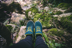 Feet Woman running shoes relaxing in forest Travel Stock Image