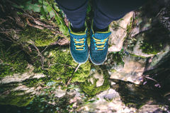 Feet Woman running shoes relaxing in forest Travel Royalty Free Stock Image