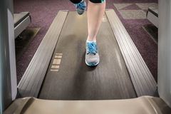 Feet of woman running on treadmill Royalty Free Stock Images