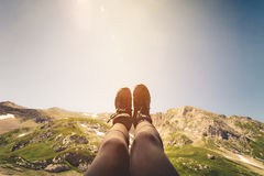 Feet Woman trekking boots relaxing outdoor Royalty Free Stock Images