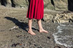 Feet of woman walking on the beach Stock Image