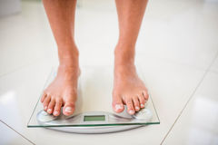 Feet of woman on weighting scale Stock Images