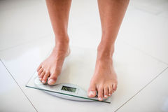 Feet of woman on weighting scale Royalty Free Stock Photography