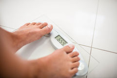Feet of woman on weighting scale Stock Image