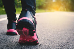 Feet women running on the road for health royalty free stock images