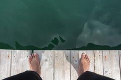 Feet on the wooden bridge Stock Image
