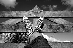 Feet on wooden fence Royalty Free Stock Photography