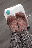 Feet with wool socks and electric heater Royalty Free Stock Photo