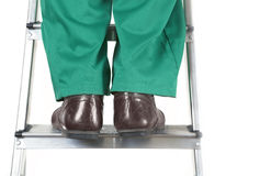 Feet of worker on ladder Royalty Free Stock Image