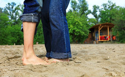 Feet of young couple on beach Stock Photos