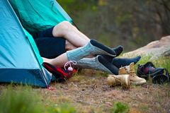 Feet of a young couple lying in a tent. Camping, travel, tourism. The Feet of a young couple lying in a tent. Camping, travel, tourism, hike and people concept Stock Images