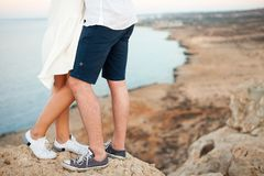 Feet of Young couple with the spectacular view on the background royalty free stock photography