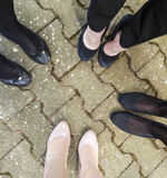 Feet of young girls standing together. At an outdoor party Royalty Free Stock Photos