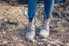 Feet of young person wearing boots outside Royalty Free Stock Photo