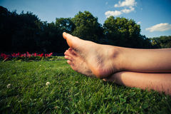 The feet of a young woman on the grass in a park Royalty Free Stock Images