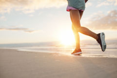 Feet of young woman jogging on the beach Royalty Free Stock Photography