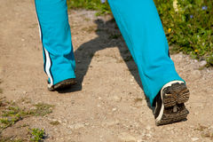 Feet of young woman jogging in the country. Summer Stock Photo