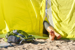 Feet of a young woman lying in a tent Stock Photo