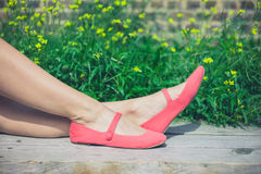 Feet of young woman relaxing on bench outside Royalty Free Stock Photography