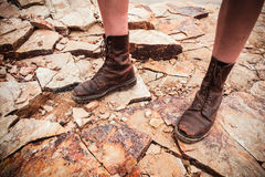 The feet of a young woman standing on some rocks Stock Photography