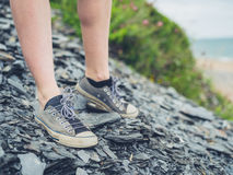 Feet of young woman on stones Stock Images