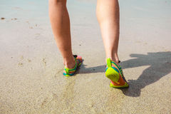 The feet of a young woman walking on the beach Stock Photos