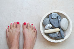 Feet and zen stones at a spa Royalty Free Stock Photography