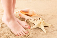 Feets and beach sand Royalty Free Stock Photos