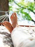 Feets em um hammock Fotografia de Stock Royalty Free