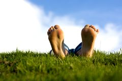 Feets on grass. royalty free stock photo