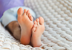 Feets in a hammock on a summer day Royalty Free Stock Image