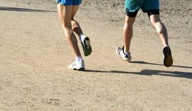 Feets Running na estrada Imagem de Stock