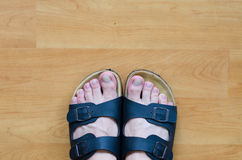 Feets on the wooden floor Royalty Free Stock Images