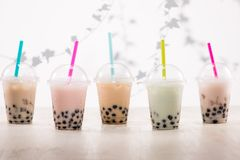 Fefreshing iced milky bubble tea with tapioca pearls in plastic Royalty Free Stock Photos