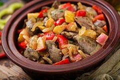 Feg lever för stek med grönsaker Arkivbild