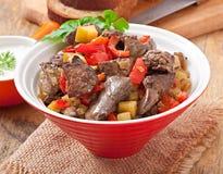 Feg lever för stek med grönsaker arkivfoton