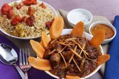 Fega curry-kyliga fega ris Arkivfoto