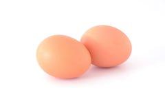 Fegt ägg på vit Arkivfoton