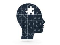 Fehlendes Puzzlespiel und menschlicher Kopf Lizenzfreie Stockfotos