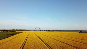 Fehmarn Bridge and Rapeseed Field Aerial View stock video footage