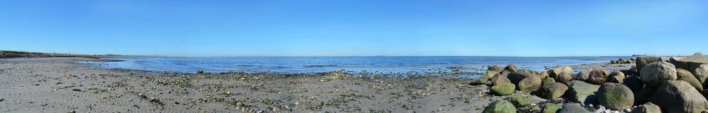 Fehmarn Island Panorama ocean sand beach. Stones Stock Images