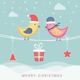 Feierkonzept der frohen Weihnachten mit Liebesvogel und hängendem c lizenzfreie abbildung